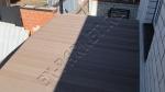 монтаж веранды вокруг дома с использованием террасной доски из ДПК Good Cover линейки Стандарт, цвет коричневый