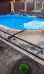 Сварочные работы, подготовка основания под укладку террасной доски вокруг бассейна и рядом