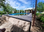 Монтаж террасной доски SaveWood Salix вокруг бассейна, торцевые элементы использованы с планкена из ДПК SW